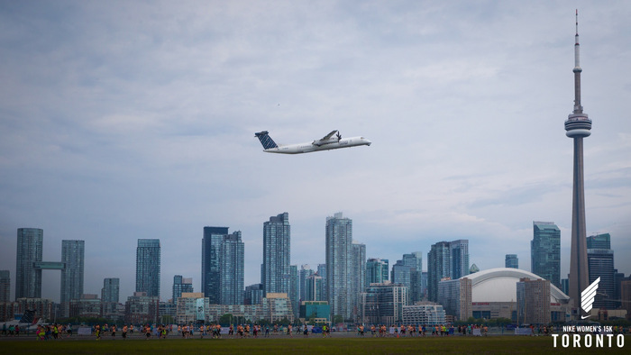 Running along the tarmac of the Billy Bishop Toronto City Airport. Photo courtesy of Nike.
